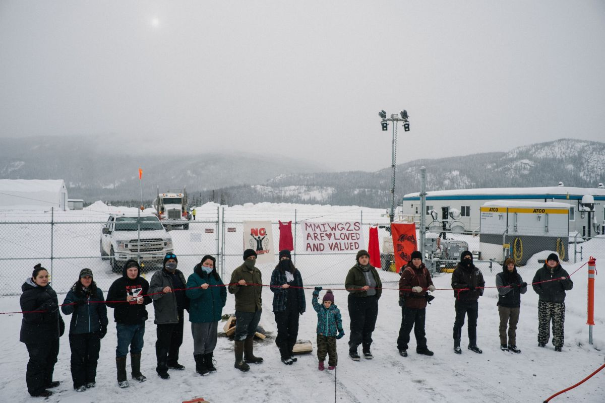 Wet'suwet'en land defenders gather outside a Coastal GasLink work sitework site on Feb. 14, 2021, for a ceremony to remember Missing and Murdered Indigenous Women and Girls