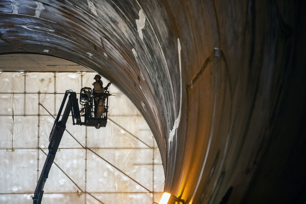 A worker is seen finishing the concrete liner of a diversion tunnel at the Site C dam project.