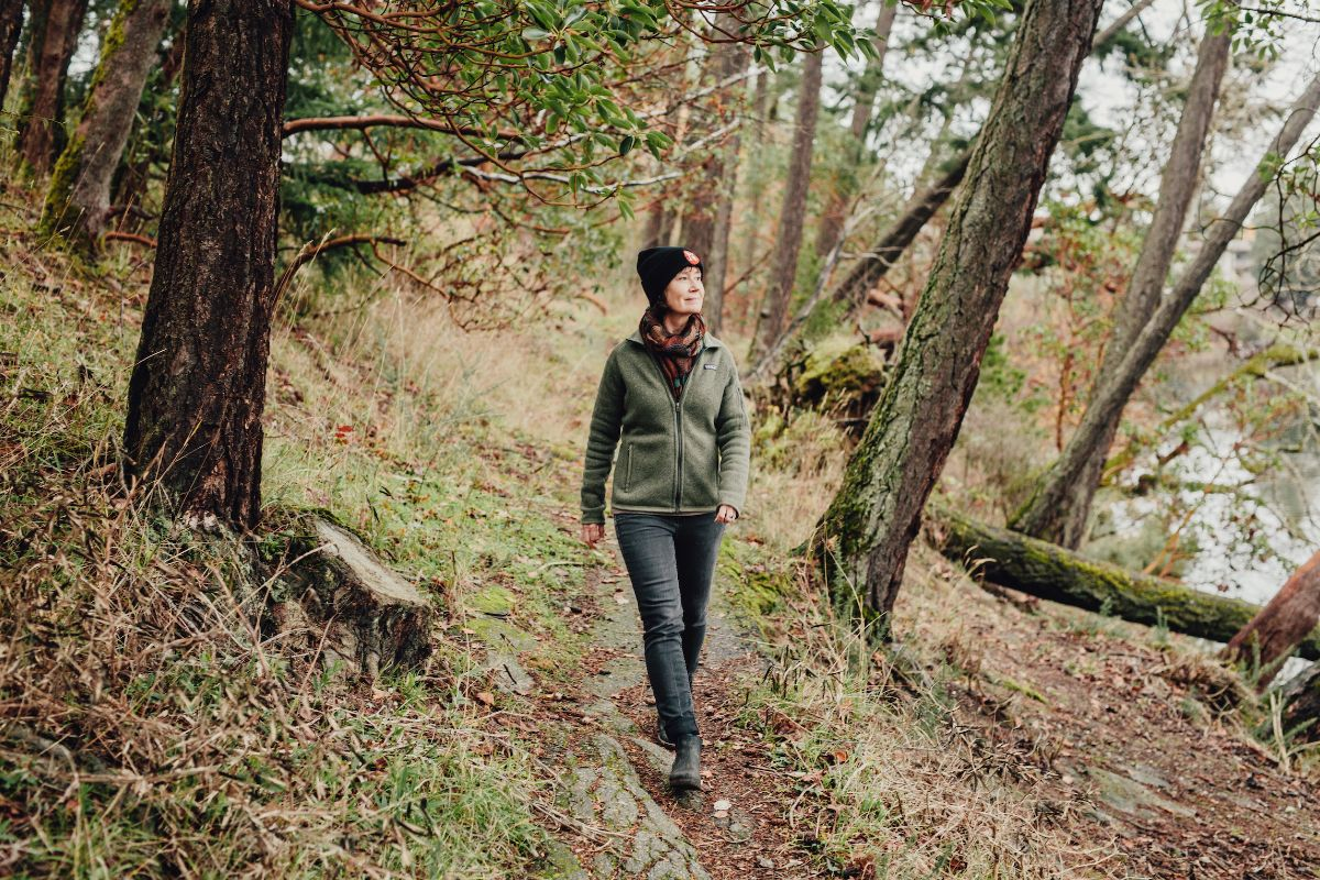 Narwhal reporter Sarah Cox walks in a forest