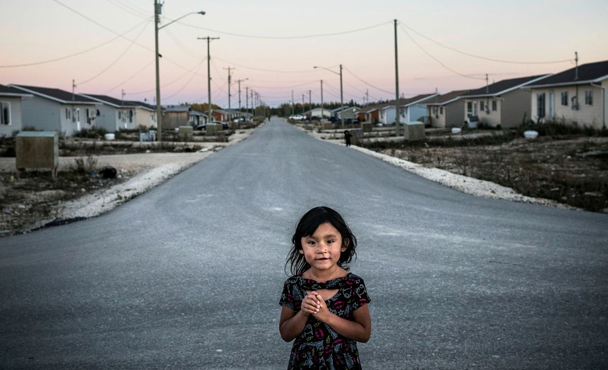 A portrait of a young girl on the streets of Easterville, Manitoba.