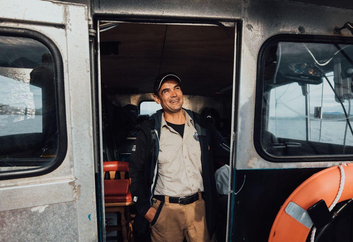 Jordan Wilson, a Heiltsuk Coastal Guardian Watchman, stands aboard one of the nation's monitoring vessels