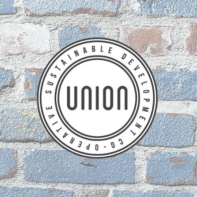 Union Sustainable Development Co-operative black and white logo on a blue and white brick background.