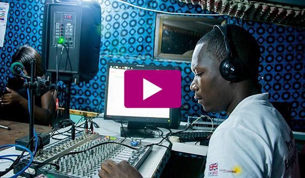Boy at a radio mixing desk.