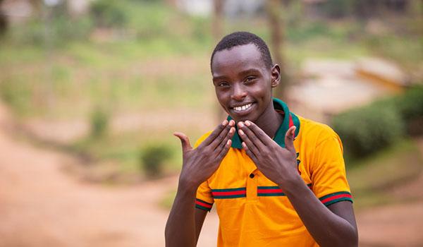 Smiling boy at Umtara School for Deaf. Rwanda.