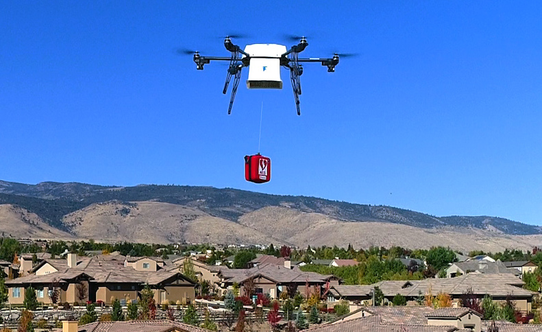 A Flirtey drone delivers an automated external defibrillator (AED) to treat cardiac arrest
