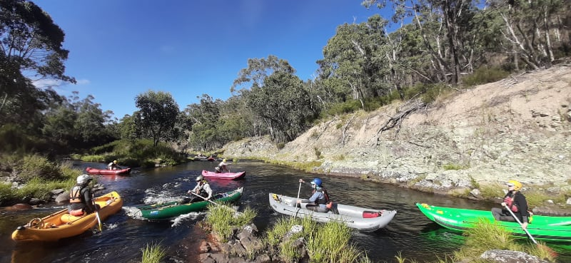6 paddlers on a river