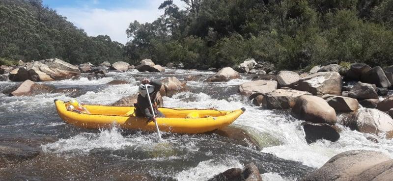 1 paddler in yellow canoe in river