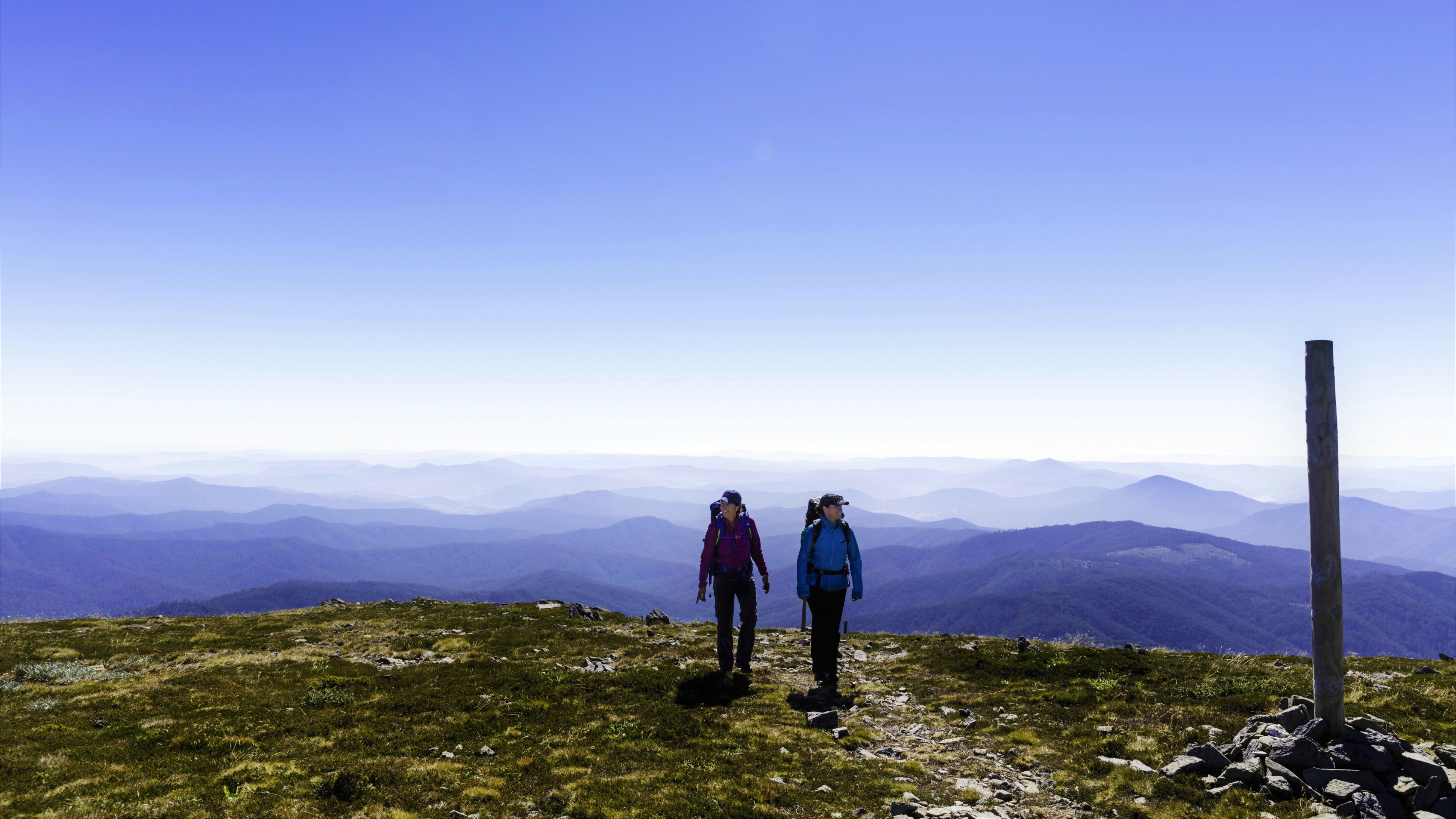 Two women hiking on top of Mt. Bogon