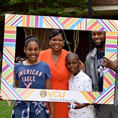 Dr. Cassandra Willis and her family at the 2019 Spring Graduation Reception in Oliver Hall Courtyard.