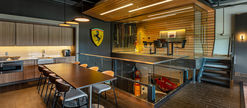 Luxury private garage with mood lighting, a kitchenette, large table and tile floors