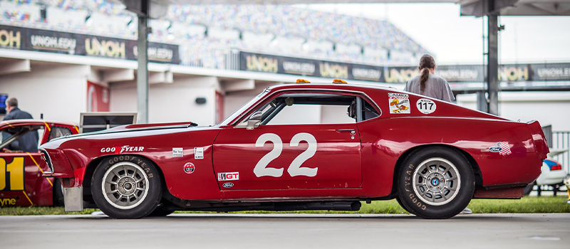 Profile view of a red number 22 race car in a track setting