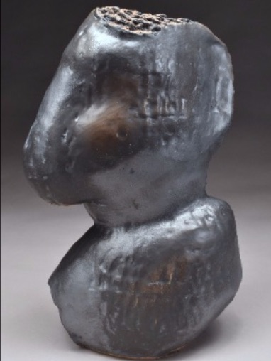 "Image of a black/brown ceramic sculpture by Robert Pulley, ""Bust"""