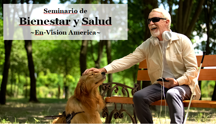 A man with white hair, mustache and goatee wearing a jacket, sunglasses and earphones attached to a smartphon sits on a park bench in a tree lined park and leans forward to pet his guide dog.  A white cane leans on the bench to his left.