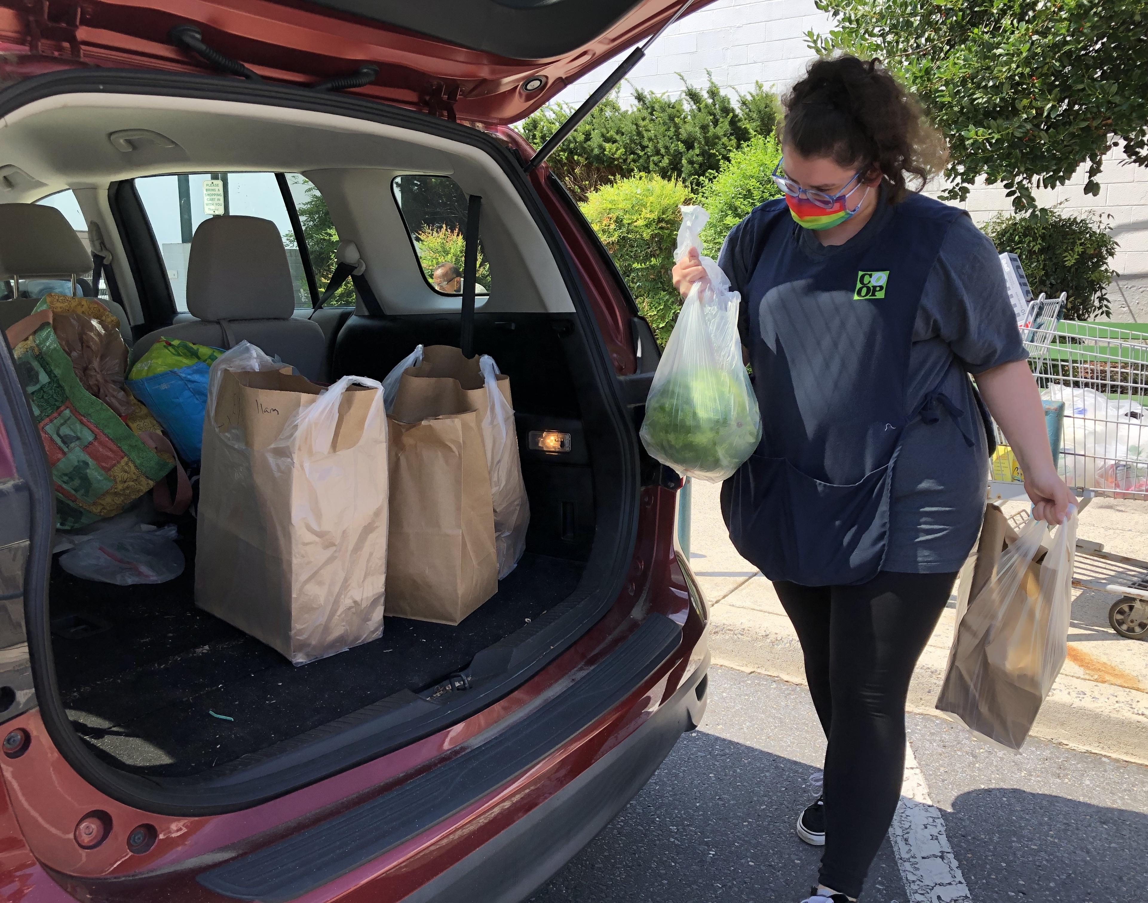 Photo: Jessica loads curbside order.