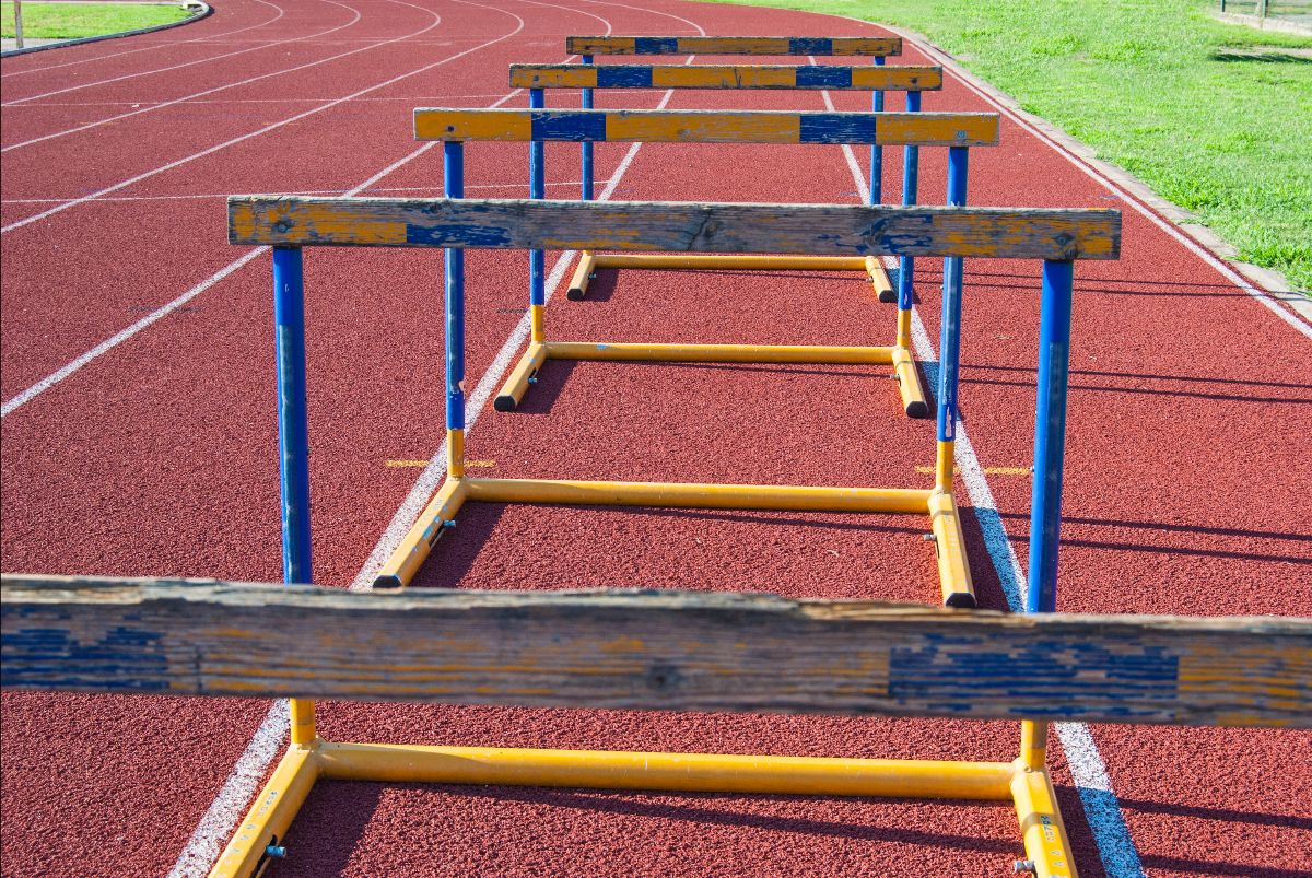 Hurdles in a line on a track