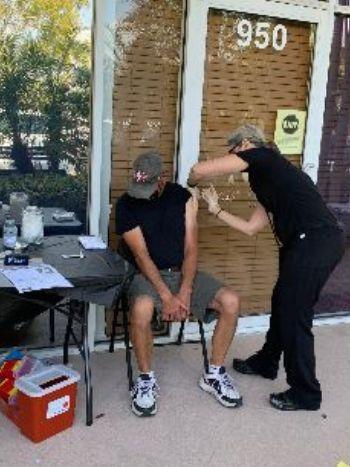 Dr Drourr vaccinating patient