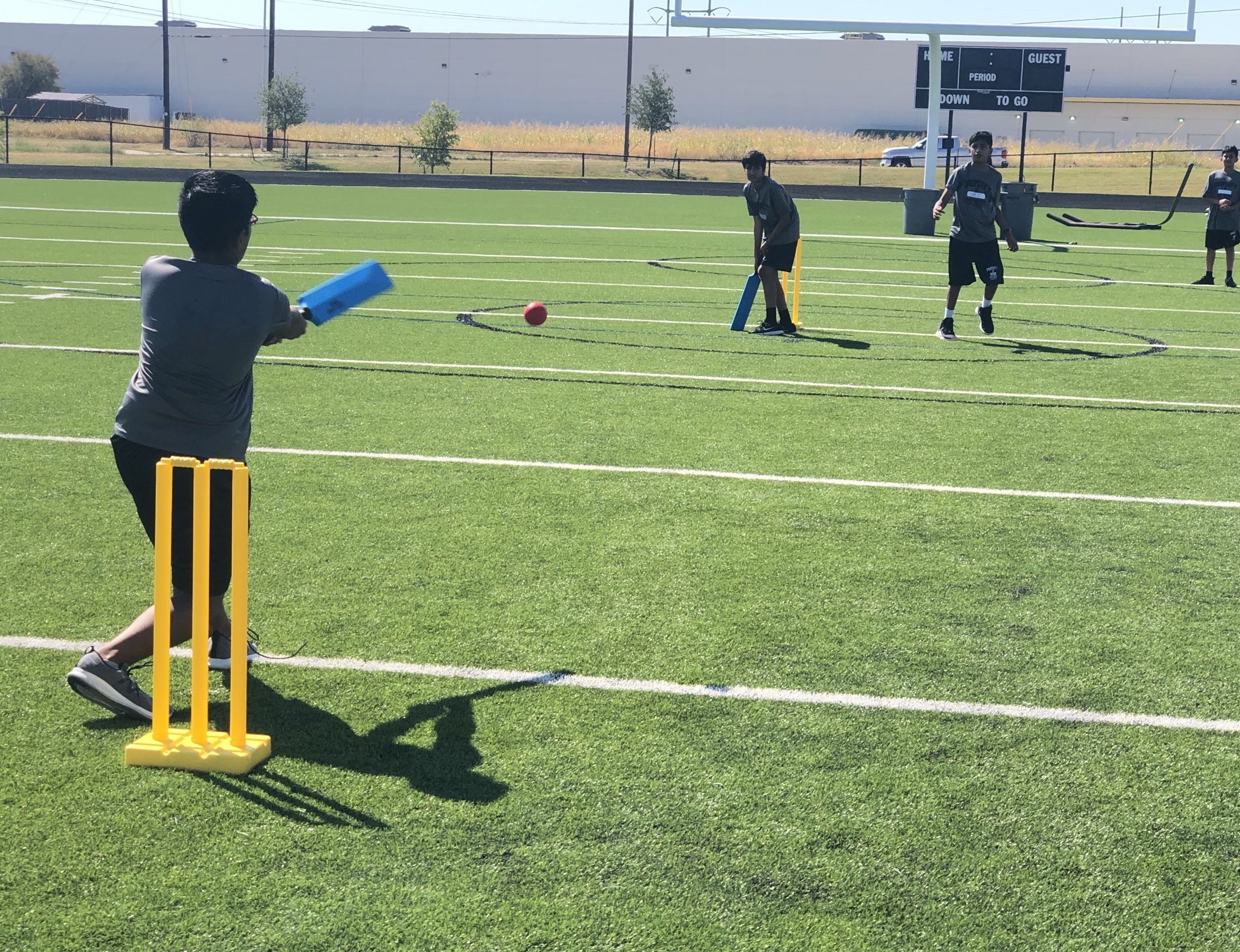 Photo of students playing cricket.