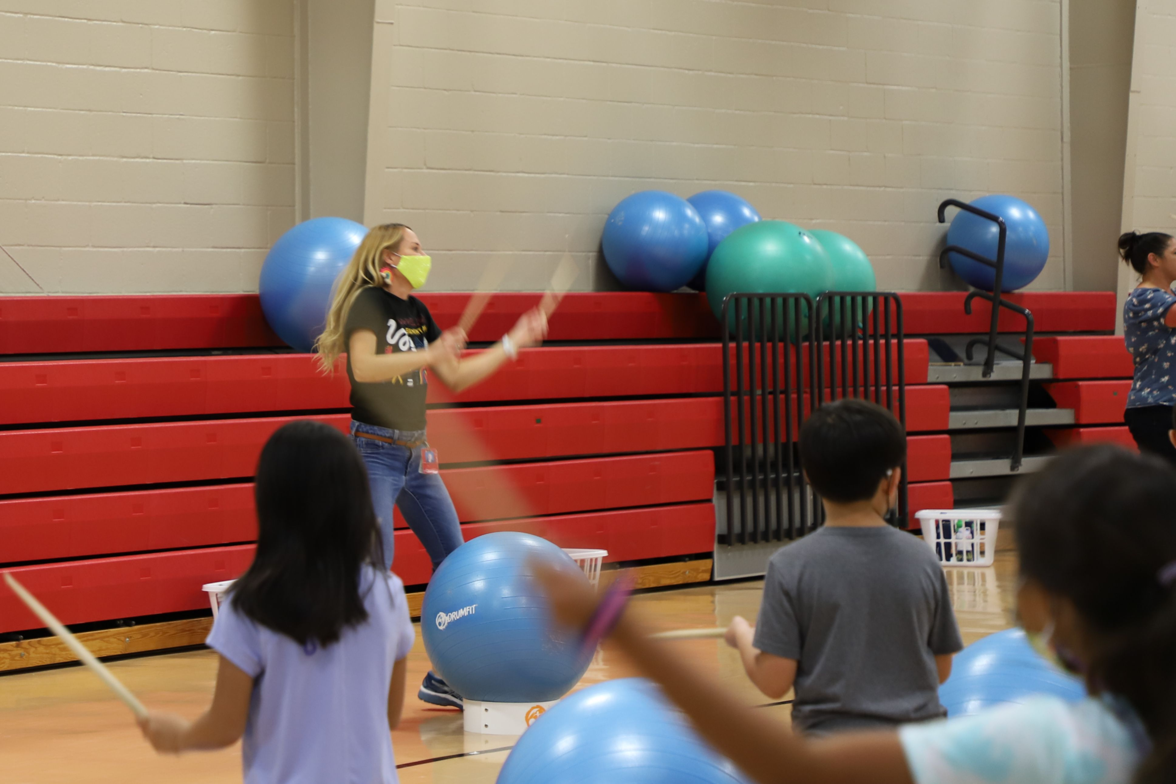 Photo of teacher leading drum fit