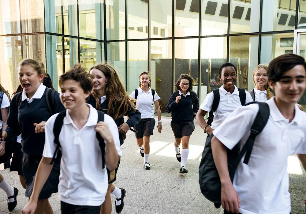 Children running out of school