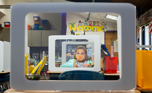 Student behind protective glass