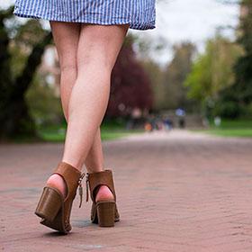 Woman walking down a brick path