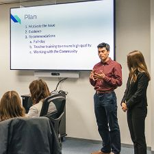 Team presenting a powerpoint presentation
