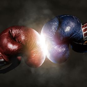 Blue and red boxing gloves clashing