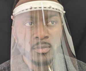 Man wearing plastic face shield