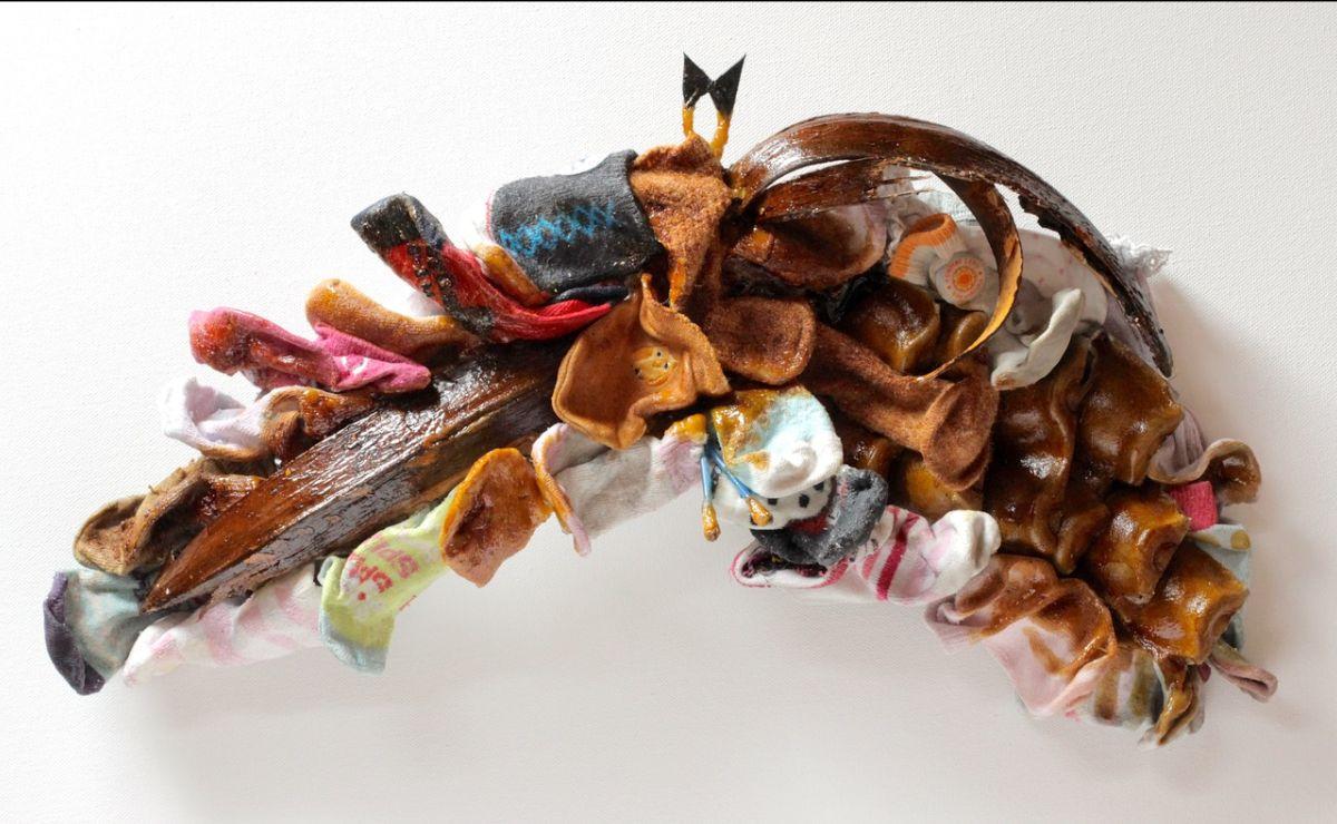 Lana Locke: Pangolin-Bat(2020) Mixed media relief; 26 cm x 47 cm x 9 cm.