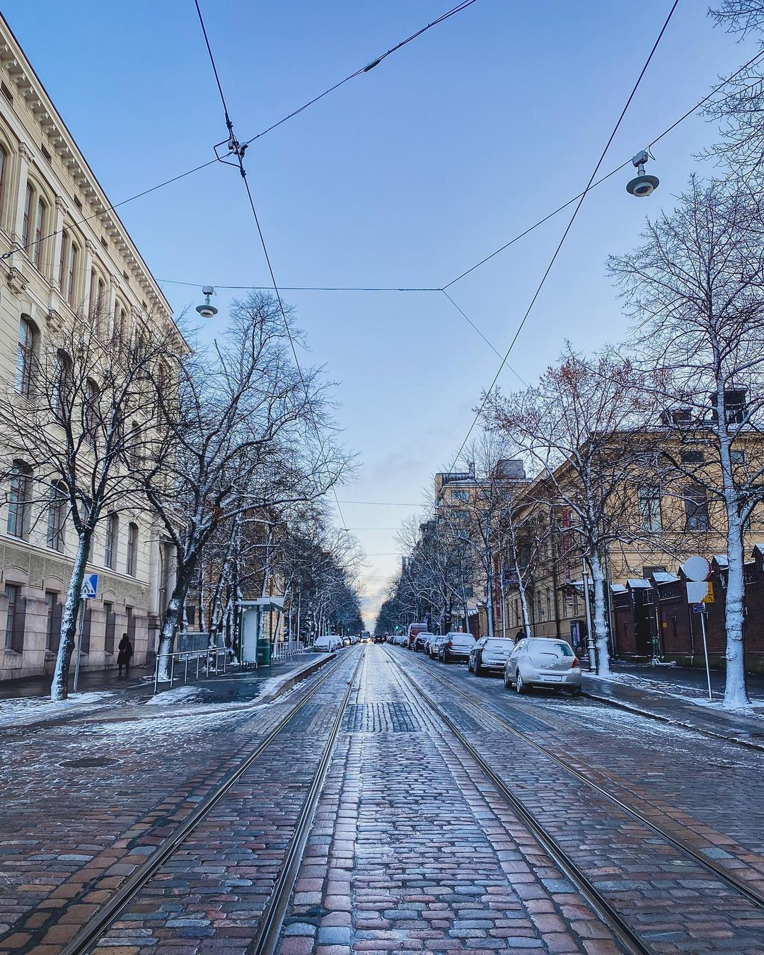 Long view of paved Helsinki street with dusting of snow