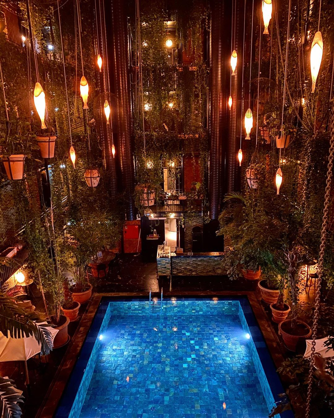 Interior pool with dramatic lighting at Manon Les Suites