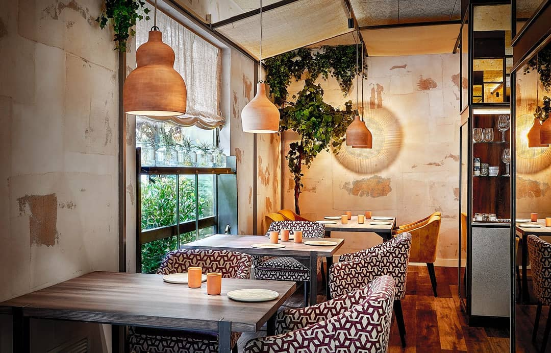 Cozy restaurant interior with hanging copper lights