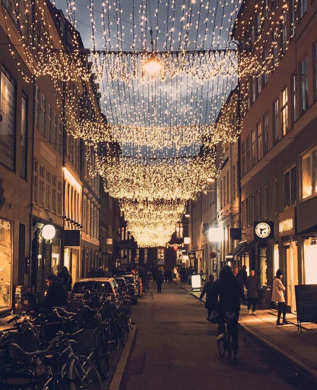 Quiet street in Copenhagen adorned with Christmas lights