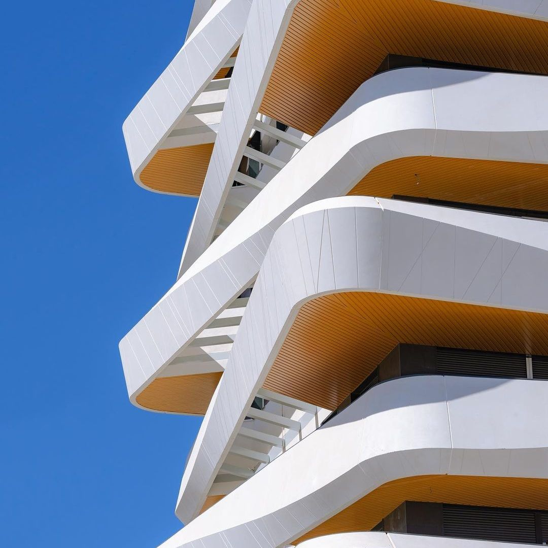 Madrid modern geometric building in white set against blue sky