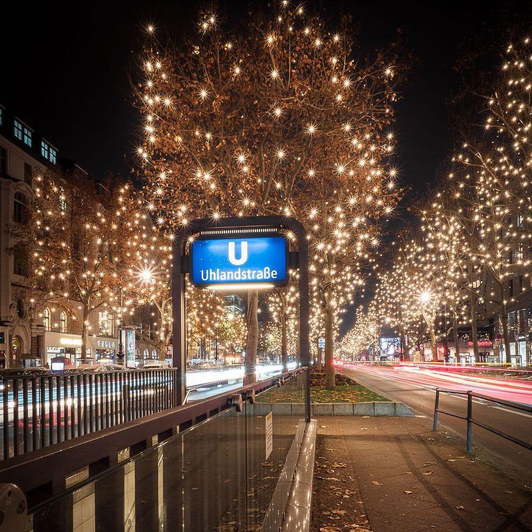 Lit Christmas trees at U-bahn stop in Berlin