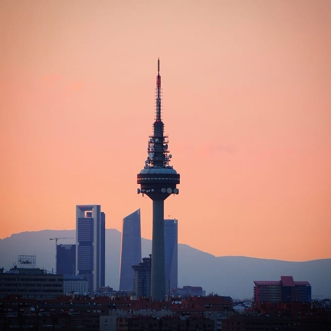 Madrid cityscape with tower and peach sky