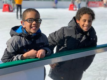 Kyler and Kayden stop skating and show their big smiles for a photo.