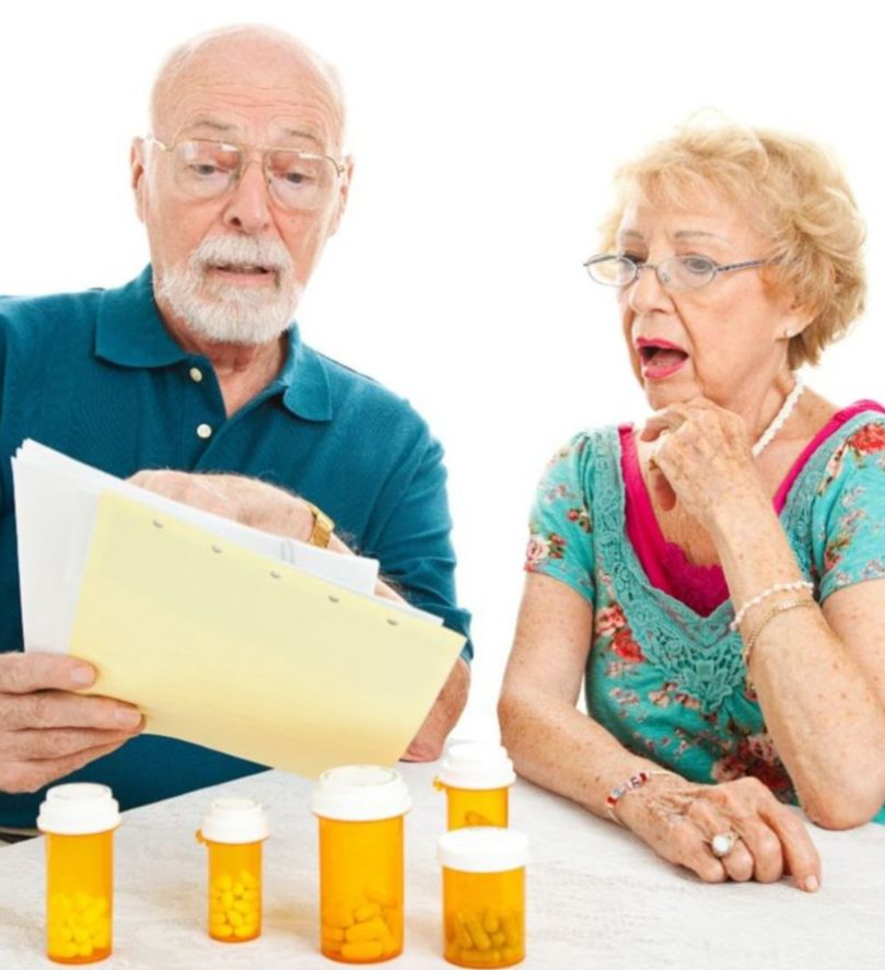 Older Couple reviewing medical bills
