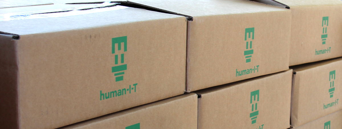 Human-IT Chomebooks in boxes, ready to ship