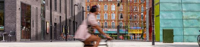 Person riding a bike through a city centre