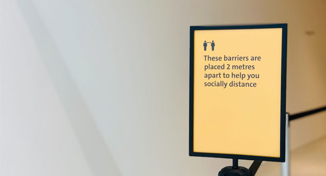 A sign telling people to socially distance by 2m