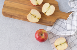 Cut apples on a wooden cutting board