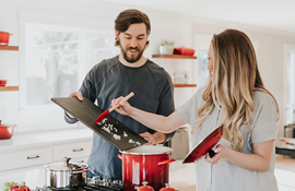 Couple cooking together in a kitchen