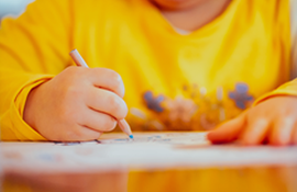 Close up of a child coloring