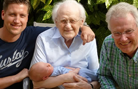 Four generations of men posing for a photo