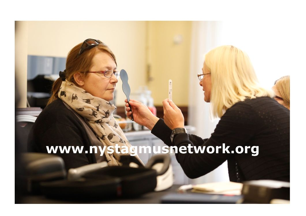 A woman is having her eyes tested.