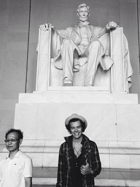 Harry Styles in front of the lincoln memorial