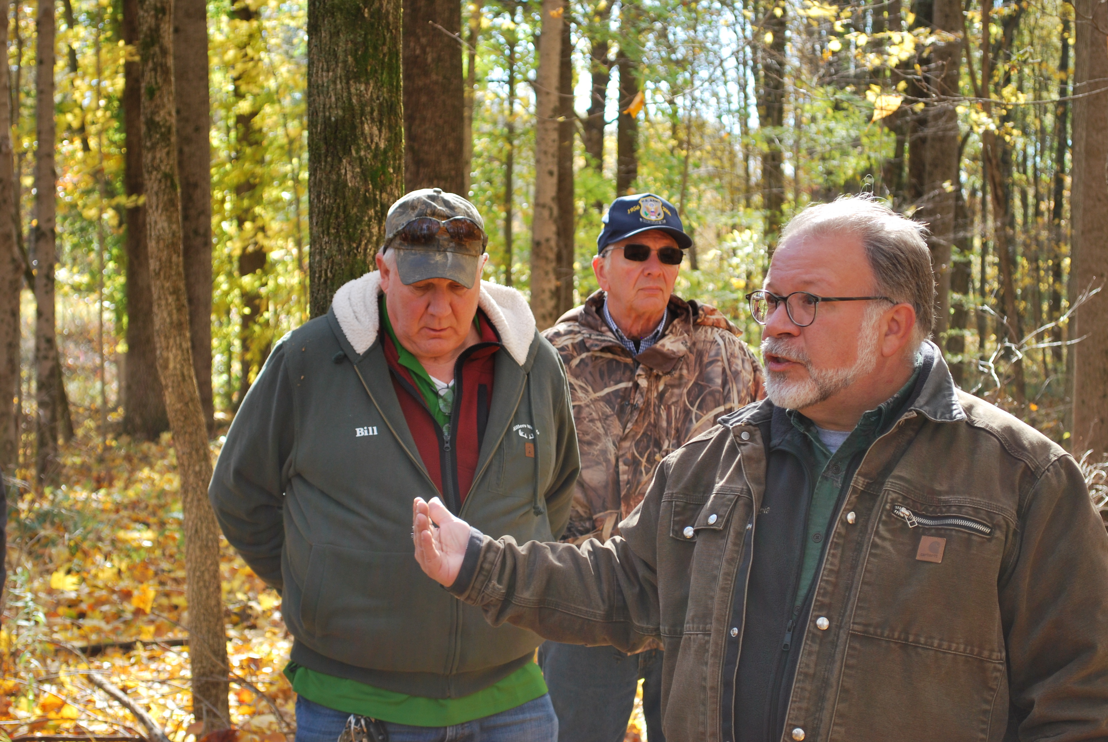 Lenny Farlee explaining forestry practice in the woods