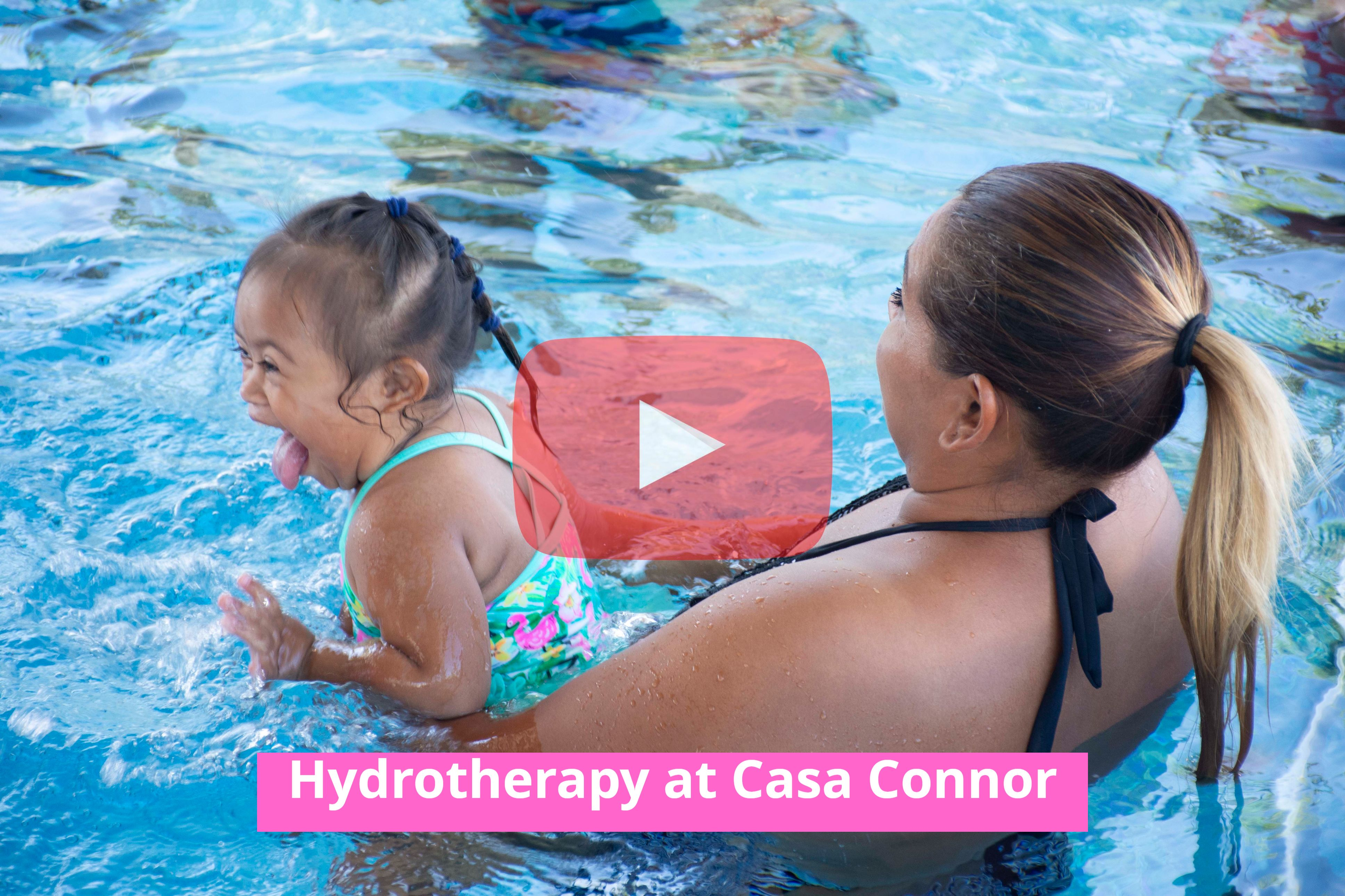 Mia and her mum bond during a hydrotherapy session