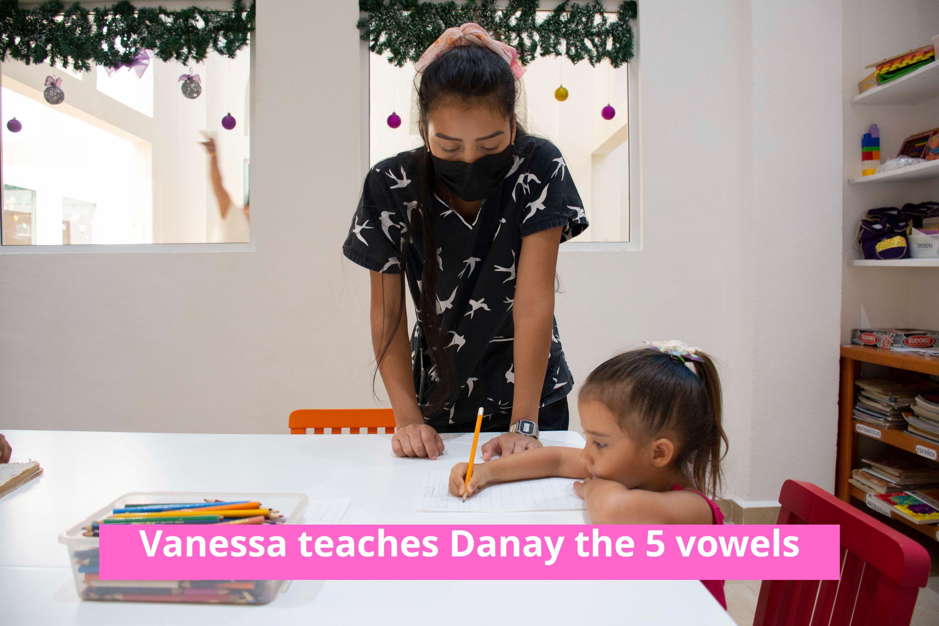 Vanessa teaches Danay the 5 vowels